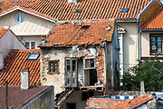 Neglected derelict property among restored homes in Castro Urdiales in Cantabria, Northern Spain