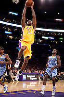 06 November 2009: Forward Josh Powell of the Los Angeles Lakers dunks the ball against the Memphis Grizzles during the second half of the Lakers 114-98 victory over the Grizzles at the STAPLES Center in Los Angeles, CA.
