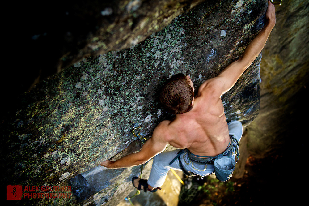 Erik Jensen hugs the face of Angular Motion 5.12a at Carver Bridge Cliff a popular climbing area near Portland. Carver is also the location used for some scenes in the Twilight movies.