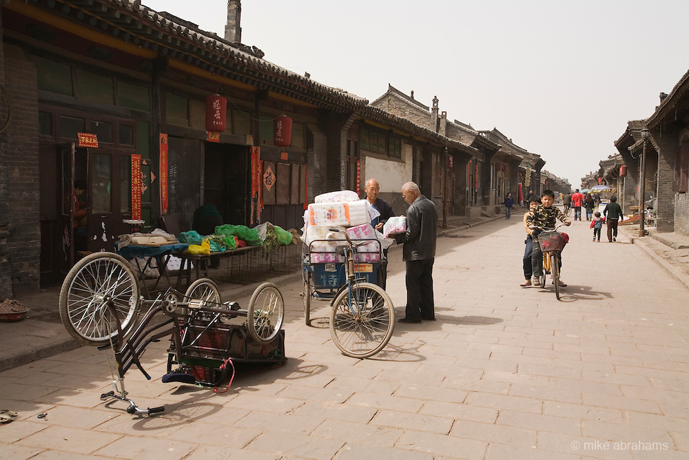 Transporting goods on a street in Pingyao, People's Republic of China