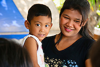 Child and mother, Ban Phe, Thailand