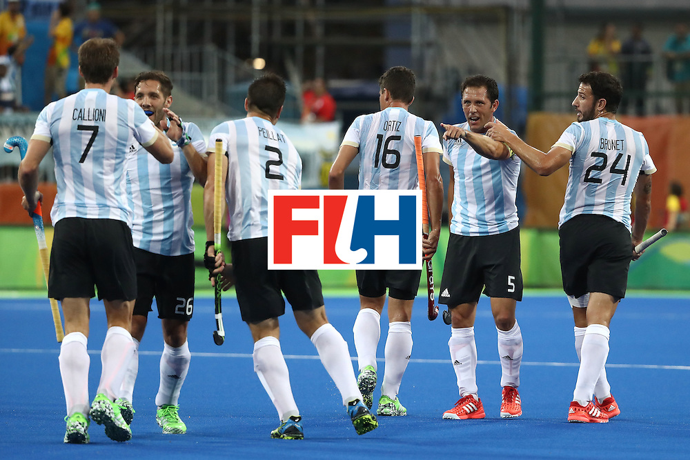 RIO DE JANEIRO, BRAZIL - AUGUST 18:  Pedro Ibarra #5 of Argentina celebrates scoring a goal during the Men's Hockey Gold Medal match between Belgium and Argentina on Day 13 of the Rio 2016 Olympic Games at Olympic Hockey Centre on August 18, 2016 in Rio de Janeiro, Brazil.  (Photo by Sean M. Haffey/Getty Images)