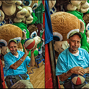 Boardwalk amusement arcade barker stuffed prize animals. <br /> <br /> <br /> Basket Ball at the Arcades shooters try to making baskets for prizes.