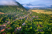 Hot air balloon flight over Vang Vieng, Laos, early in the morning.