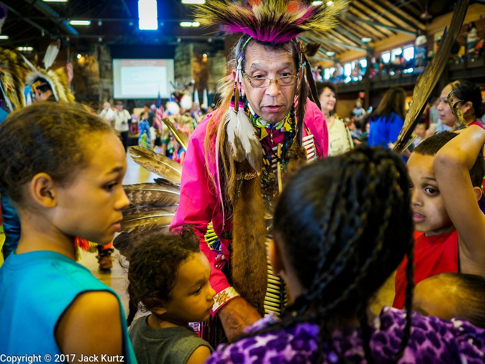 06 MAY 2017 - ST. PAUL, MN: A tribal elder talks to young people at the 6th Annual Powwow for Hope at Ft. Snelling in St. Paul. The powwow was a fundraiser to support cancer education and supportive services for American Indian communities. Proceeds benefited the American Indian Cancer Foundation's work to eliminate cancer burdens on American Indian families. Cancer is the leading cause of death in Native American communities, exceeding coronary disease and diabetes.       PHOTO BY JACK KURTZ