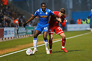 Jordan Tunnicliffe and Frank Nouble compete for the ball during the EFL Sky Bet League 2 match between Colchester United and Crawley Town at the JobServe Community Stadium, Colchester, England on 1 January 2020.