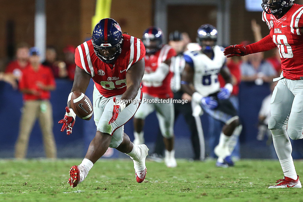 Lauren Wood | Buy at photos.djournal.com<br /> Ole Miss defensive tackle D.J. Jones picks up the fumble for a return during Saturday night's game against Memphis.