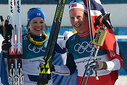 February 25, 2018 - Pyeongchang, South Korea - KRISTA PARMAKOSKI of Finland (left) and MARIT BJOERGEN of Norway pose for a photograph after the Ladies' 30km Mass Start Classic cross-country ski racing event in the PyeongChang Olympic Games. (Credit Image: © Christopher Levy via ZUMA Wire)