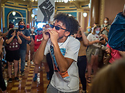 15 JUNE 2020 - DES MOINES, IOWA: CHARLES WALKER, a member of Black Lives Matter, protests in front of the Governor's Reception Room in the Iowa capitol in Des Moines. About 75 supporters of Black Lives Matter marched through the Iowa capitol Monday to demand the restoration of voting rights for felons who have completed their sentences. Iowa is one of only two states in the US that permanently strip felons of voting rights. The issue is a  racial one in Iowa. Blacks make up only 4 percent of the population but 25 percent of the prison population. The Governor agreed to meet with a delegation of the protesters but she would not commit to immediately restoring voting rights. She said would draft an executive order to restore voting rights later in the summer.   PHOTO BY JACK KURTZ