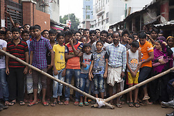 July 4, 2017 - Gazipur, Bangladesh - July 04, 2017- Gazipur, Bangladesh- Bangladeshi people stand near the factory to see the rescue programme on July 4, 2017, after a boiler explosion at the complex on the outskirts of Dhaka. At least 10 people were killed and three remained missing on the second day of a boiler explosion incident at a garment factory in Bangladesh, officials said Tuesday. © Monirul Alam (Credit Image: © Monirul Alam via ZUMA Wire)
