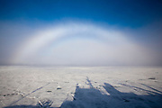 Fogbow, or cloudbow over sea ice, known as a sea-dog to mariners, photographed in an Arctic fog near the Seven Islands, Sjuøyane, northeast Svalbard, from the deck of the Greenpeace ship Esperanza.