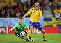 Petter Hansson of Sweden goes close to scoring but it is saved by Igor Akinfeev of Russia