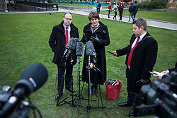 © Licensed to London News Pictures. 21/02/2018. London, UK. DUP Leader ARLENE FOSTER (C) and DUP Deputy Leader NIGEL DODDS (L) give a statement to the press after meeting with Prime Minister Theresa May. Photo credit: Rob Pinney/LNP