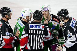 John Hughes (HDD Tilia Olimpija, #72) and Jamie Fraser (HDD Tilia Olimpija, #44) talking to referees during ice-hockey match between HDD Tilia Olimpija and SAPA Fehervar AV19 at second match in Quarterfinal  of EBEL league, on Februar 21, 2012 at Hala Tivoli, Ljubljana, Slovenia. HDD Tilia Olimpija won 2:1 in OT. (Photo By Matic Klansek Velej / Sportida)