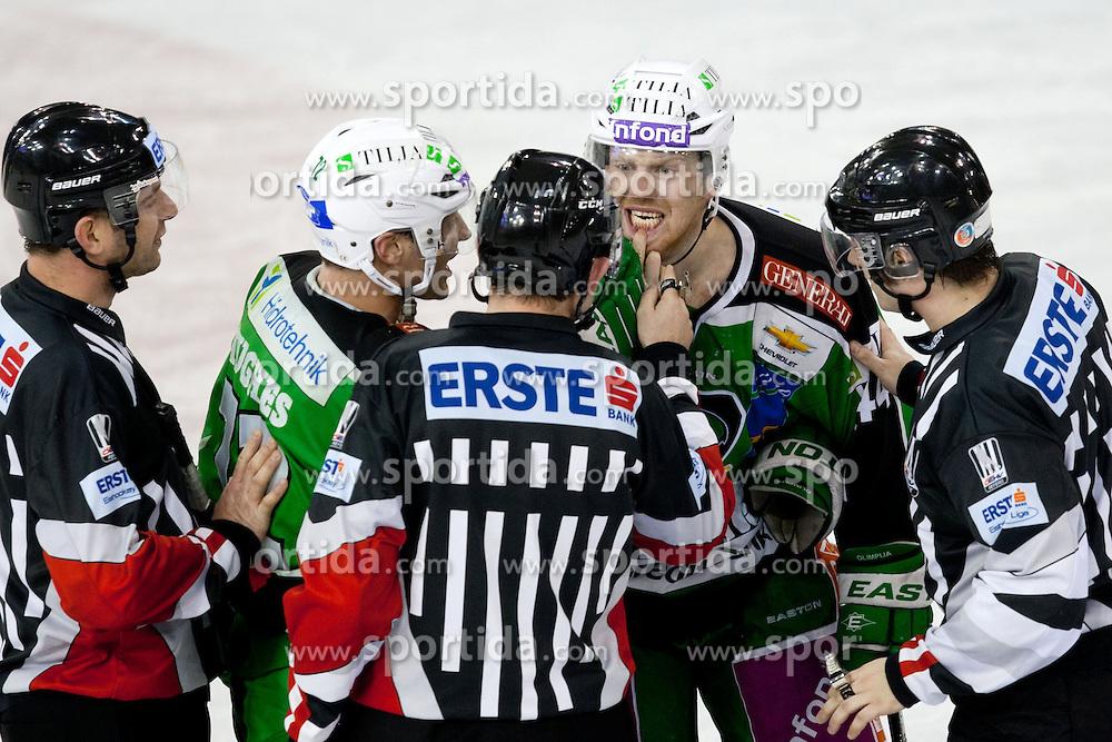 John Hughes (HDD Tilia Olimpija, #72) and Jamie Fraser (HDD Tilia Olimpija, #44) talking to referees during ice-hockey match between HDD Tilia Olimpija and SAPA Fehervar AV19 at second match in Quarterfinal  of EBEL league, on Februar 21, 2012 at Hala Tivoli, Ljubljana, Slovenia. HDD Tilia Olimpija won 2:1 in OT. (Photo By Matic Klansek Velej / Sportida)