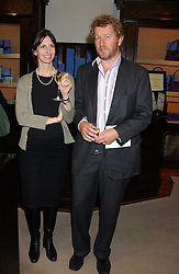 Writer SEBASTIAN FAULKS and his wife VERONICA at a party to celebrate the launch of The Monneypenny Diaries at Smythson, 40 New Bond Street, London W1 on 4th October 2005.<br />