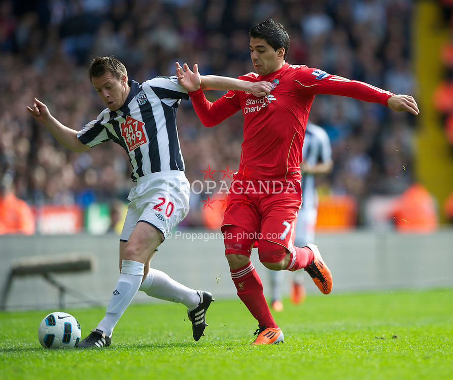 WEST BROMWICH, ENGLAND - Saturday, April 2, 2011: West Bromwich Albion's Nicky Shorey and Liverpool's Luis Alberto Suarez Diaz during the Premiership match at The Hawthorns. (Photo by Dave Kendall/Propaganda)