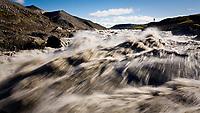 Við Rauðuflúð í Jökulsá á Brú. Þessi staður er ekki lengur til þar sem hann fór undir Hálslón Kárahnjúkavirkjunar. Andri Snær Magnason sést í fjarska.<br /> <br /> By Raudaflud in glacier river Jökulsá á Brú. This magnificent place no longer exist due to the Hálslón Reservoir which was made for Kárahnjúkavirkjun Hydro Power Plant in Iceland.
