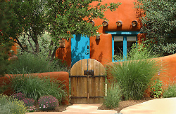 orange adobe Santa Fe cottage