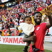 HARRISON, NEW JERSEY- OCTOBER 16:  Kemar Lawrence #92 of New York Red Bulls salutes the fans at the end of game celebrations during the New York Red Bulls Vs Columbus Crew SC MLS regular season match at Red Bull Arena, on October 16, 2016 in Harrison, New Jersey. (Photo by Tim Clayton/Corbis via Getty Images)