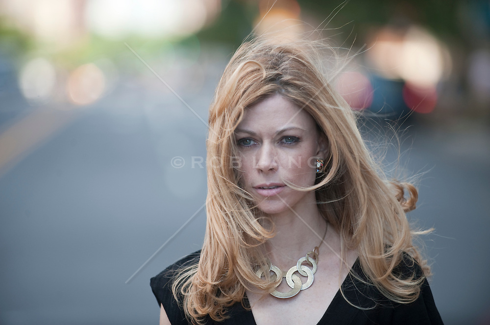 Woman with long blonde hair blowing in the wind
