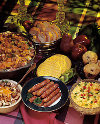 assortment breakfast items waffles sausage hash brown potato scrambled eggs red green peppers blueberry muffins apple butter
