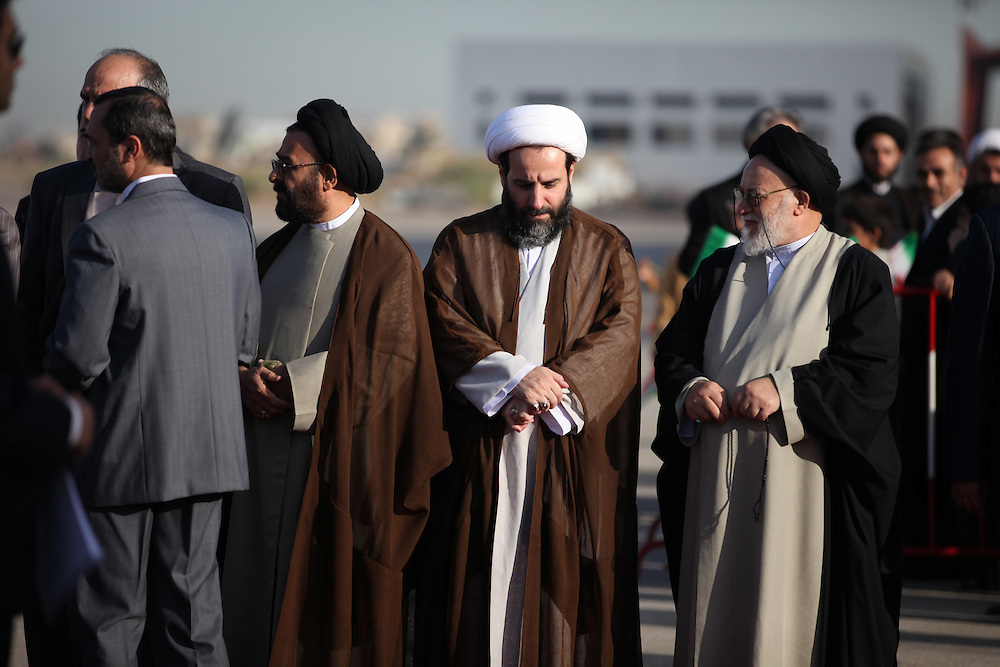 Shia clerics wait to welcome Ahmadienjad.