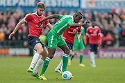 Ntumba Massanka (on loan from Burnley) (Wrexham AFC) holds off the York City player, controls the ball and sets up another Wrexham attack during the Vanarama National League match between York City and Wrexham FC at Bootham Crescent, York, England on 17 April 2017. Photo by Mark P Doherty.