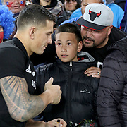 Sony Bill Williams amazed Mason Smales with a gift of his red striped Adidas game shoes.  Mason is a cousin of the late beloved Peter Fatialofa. The New Zealand All Blacks defeated Manu Samoa 15's 83-0 at Eden Park, Auckland, New Zealand.  Photo by Barry Markowitz, 6/16/17