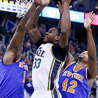 09 December 2015: Utah Jazz forward Trevor Booker (33) goes for the layup past New York Knicks forward Lance Thomas (42) and New York Knicks center Kevin Seraphin (1) during the Utah Jazz 106-85 victory over the New York Knicks, at the Vivint Smart Home Arena, Salt Lake City, Utah, USA.