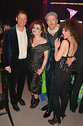 Left to right, DOMINIC WEST, HELENA BONHAM-CARTER, DAMIAN LEWIS and HELEN McCRORY at A Night of Reggae in aid of Save The Children held at The Roundhouse, Chalk Farm Road, London NW1 on 12th March 2014.