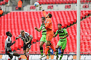 Grimsby Town's goalkeeper James McKeown punches the ball clear during the Conference Premier Final match between Forest Green Rovers and Grimsby Town FC at Wembley Stadium, London, England on 15 May 2016. Photo by Shane Healey.