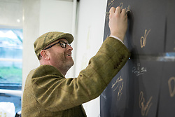 © Licensed to London News Pictures . 28/01/2017 . Stoke-on-Trent , UK . PAUL NUTTALL signs the wall of the shop . UKIP formally launch their campaign in the by-election in the constituency of Stoke-on-Trent Central , at their new campaign shop at 1 Piccadilly in Stoke , with candidate - and party leader - Paul Nuttall . The seat was vacated when Tristram Hunt resigned . Photo credit : Joel Goodman/LNP