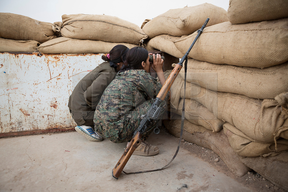 © Licensed to London News Pictures. 28/09/2014. Rabia, Iraq.<br /> <br /> Facing each other across the Iraq-Syria border, the towns of Al-Yarubiyah, Syria, and Rabia, Iraq, were taken by Islamic State insurgents in August 2014. Since then The town of Al-Yarubiyah and parts of Rabia have been re-taken by fighters from the Syrian Kurdish YPG. At present the situation in the towns is static, but with large exchanges of sniper and heavy machine gun fire as well as mortars and rocket propelled grenades, recently occasional close quarter fighting has taken place as either side tests the defences of the other. Photo credit: Matt Cetti-Roberts/LNP