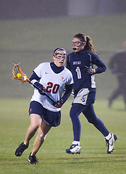 Virginia Cavaliers A Kate Breslin (20) runs past Georgetown Hoyas Schuyler Sutton (1).  The Virginia Cavaliers Women's Lacrosse team hosted the Georgetown Hoyas at Klockner Stadium in Charlottesville, VA on April 11, 2007.  UVA lead GU 7-3 with 2:45 remaining in the first half.