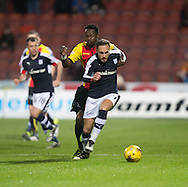 Dundee&rsquo;s Tom Hateley goes past Partick Thistle's Abdul Osman - Partick Thistle v Dundee in the Ladbrokes Scottish Premiership at Firhill, Glasgow - Photo: David Young, <br /> <br />  - &copy; David Young - www.davidyoungphoto.co.uk - email: davidyoungphoto@gmail.com
