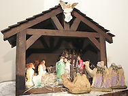 "Peggy Thoma's Nativity Scene, made by her father using the wooden box he used to ship things home from Korea. Thoma says that, ""each neighbor on the street then bought a figure to furnish the complete manger."""