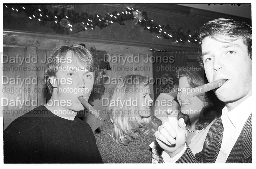 Caribou Club in Aspen, Colorado,  men with cigars, 1995© Copyright Photograph by Dafydd Jones 66 Stockwell Park Rd. London SW9 0DA Tel 020 7733 0108 www.dafjones.com