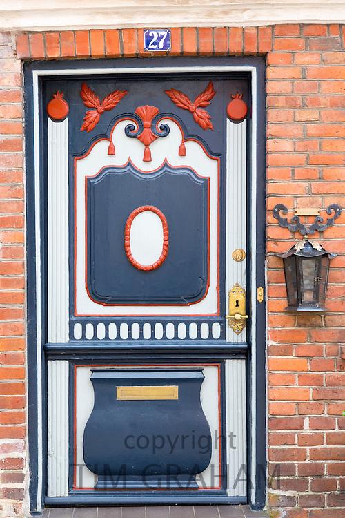 Painted ornate door in medieval Ribe centre, South Jutland, Denmark
