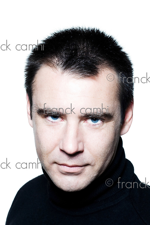 handsome caucasian man serious seductor smiling short brown with polo turtle neck hair blue eyes portrait expressing portrait on studio isolated white background