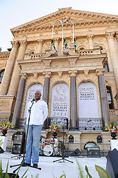 CHESTER WILLIAMS, 1995 Rugby World Cup winner and former Springbok addresses the crowd. The City of Cape Town hosted an interfaith service on the Grand Parade as the day was declared a national day of prayer and reflection on the life of Nelson Mandela. Visitors also placed flowers and condolence messages on the barricade erected to accommodate it. Various religious leaders said prayers for the late South African President, Cape Town, South Africa, Sunday, 8th December 2013. Picture by Roger Sedres / i-Images