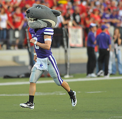 "Oct 07, 2010; Manhattan, KS, USA;  The Kansas State Wildcats mascot ""Willie"" runs on the field before the game against the Nebraska Cornhuskers at Bill Snyder Family Stadium. Nebraska won 48-13. Mandatory Credit: Denny Medley-US PRESSWIRE"