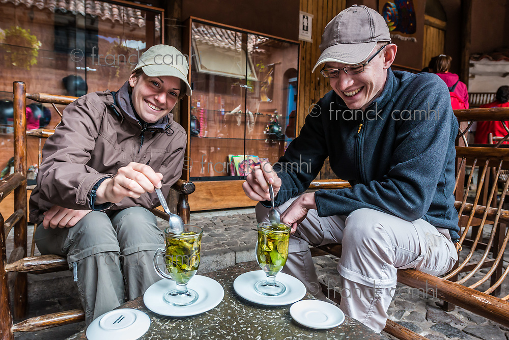 Pisac, Peru - July 14, 2013: Tourists drinking coca tea in the peruvian Andes at Pisac Peru on july 14th, 2013