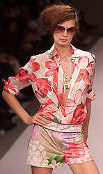 Paul Smith Spring/Summer 2001 London Fashion Week.Model wears brown zebra striped playsuit and head scarf with belt, September 28, 2000. Photo by Andrew Parsons / i-Images..
