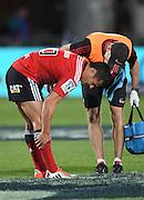 An injured Dan Carter. Crusaders v Rebels. Super Rugby. Christchurch, New Zealand. Friday 13 February 2015. Copyright Photo: Andrew Cornaga / www.photosport.co.nz