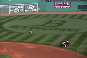 10/22/13 — BOSTON — The Fenway Park grounds crew prepares the field for the World Series on Oct. 22, 2013.