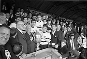 31/05/1964<br /> 05/31/1964<br /> 31 May 1964<br /> Presentation of Bradmola Cup at Tolka Park, Dublin. Grange United defeated Cherry Orchard 2-0. Picture shows Mr. Charlie Liddy, Chairman A.U.L. presenting the Bradmola Cup to Joe Clark the Grange Captain. Also included are Mr. Jim Younger, Honorary Secretary A.U.L and Mr. Sean Monahan, Honorary Secretary Grange United.
