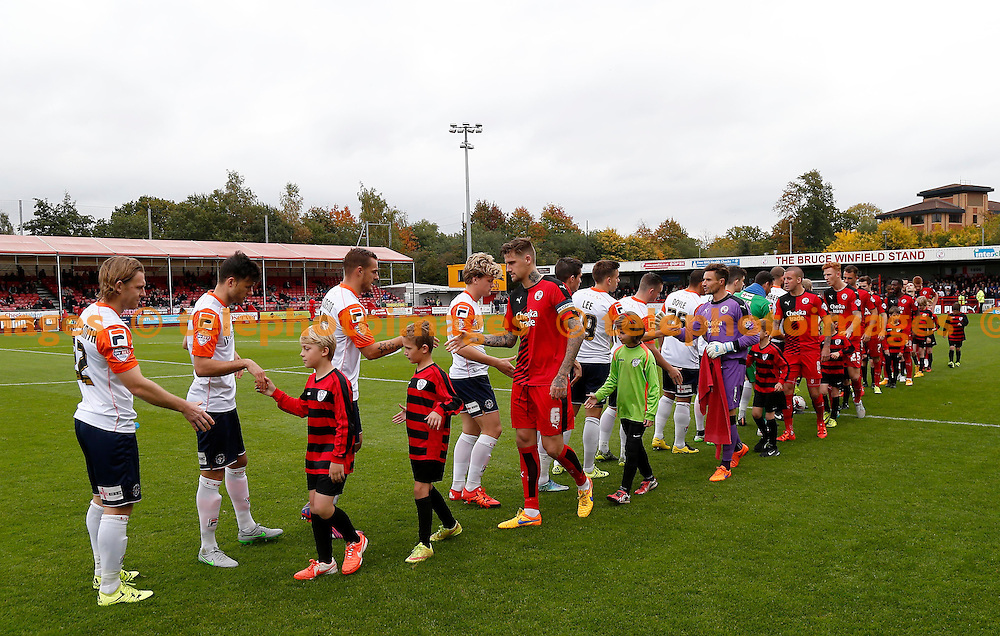Teams come out during the Sky Bet League 2 match between Crawley Town and Luton Town at the Checkatrade.com Stadium in Crawley. October 17, 2015.<br /> James Boardman / Telephoto Images<br /> +44 7967 642437