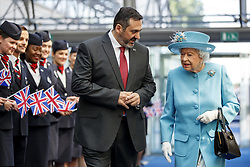 Queen Elizabeth II is accompanied by Chief Executive of British Airways, Alex Cruz during her visit to the headquarters of British Airways at Heathrow Airport, London, to mark their centenary year.
