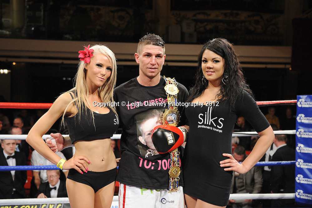 Ringcard girls pictured with Brian Rose who defeats Max Maxwell for the British Light Middleweight Champion at The Winter Gardens, Blackpool on the 31st March 2012. Frank Maloney and Steve Wood VIP Promotions. © Leigh Dawney Photography 2012.